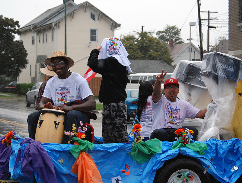 The rain did not dampen the spirits of these men participating in the parade.  The parade's theme was BAILAMOS!- Let's Dance!