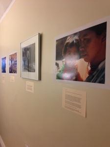 Photos line the walls at the ¡Buen Vivir! Gallery.