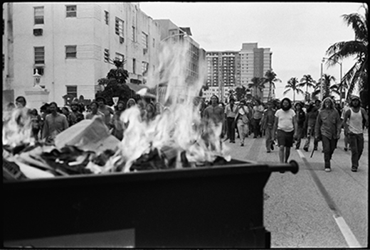 A dumpster on fire during the 1972 Republican National Convention in Miami Beach, FL. Demonstrators showed their outrage as they protest the lives lost (both U.S. and Vietnamese) in the Vietnam War. Thousands of anti-war demonstrators massed at the convention to show their opposition to the war.  Photo: Langelle