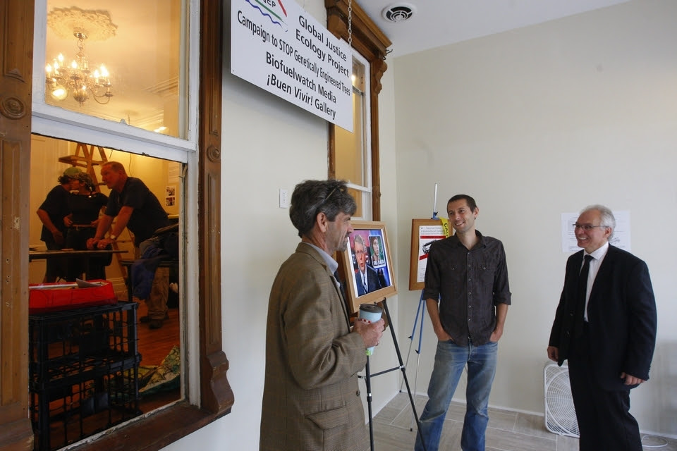 Leslie J. Pickering, center, talks with his attorneys Daire B. Irwin, left, and Michael Kuzma during the installation of his exhibit at the ¡Buen Vivir! Gallery in Buffalo on Tuesday. Photos by Mark Mulville/Buffalo News