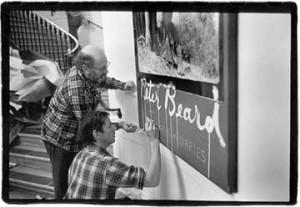 Designer Marvin Israel (left) and artist PeterBeard during the 1978 installation at the International Center of Photography in Manhattan. Photo: Langelle