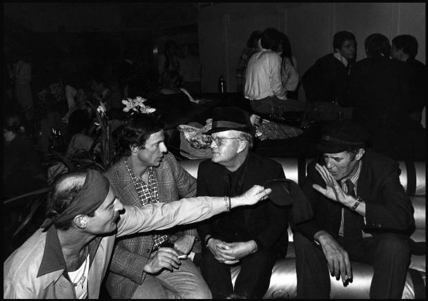 Truman Capote with Peter Beard at Studio 54 during Beard's 40th birthday party.
