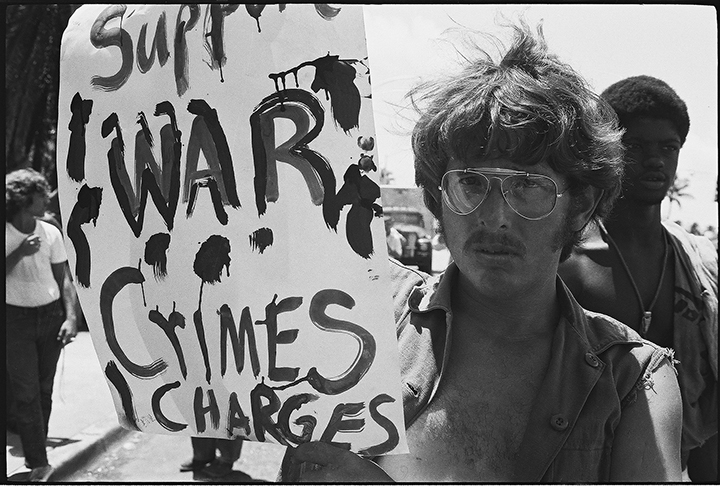 SUPPORT WAR CRIMES CHARGES sign held by an anti-Vietnam War protest during the 1972 Republican National Convention in Miami Beach, FL. photo: Langelle
