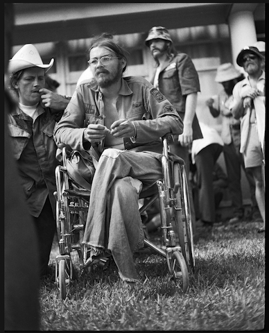 Wounded soldier from the Vietnam Veterans Against the War (VVAW) in wheelchair during protests at 1972 Republican National Convention in Miami Beach, FL, Photo: Langelle